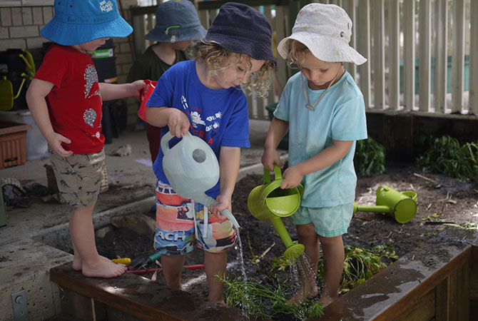 Junior Kindy - watering the new garden