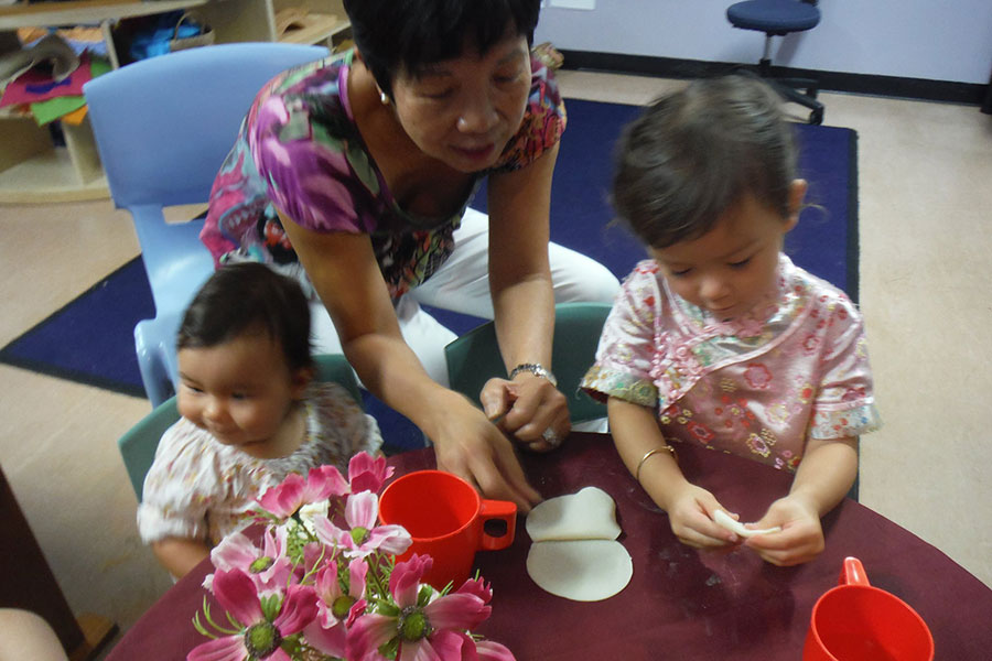 Grandmother sharing with kindy children