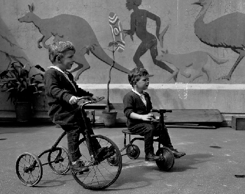 Outside on trikes - 1944