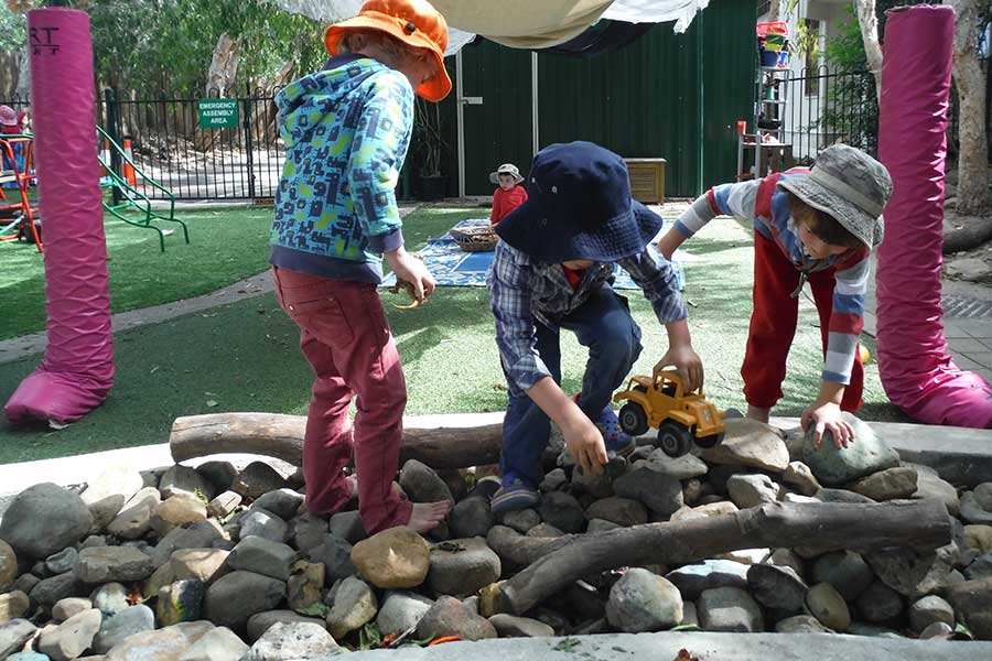 Kindy - Playing in the rock garden